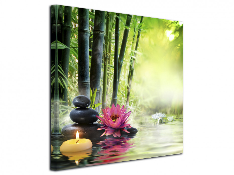 Tableau zen bougie et galet sur forêt de bambou