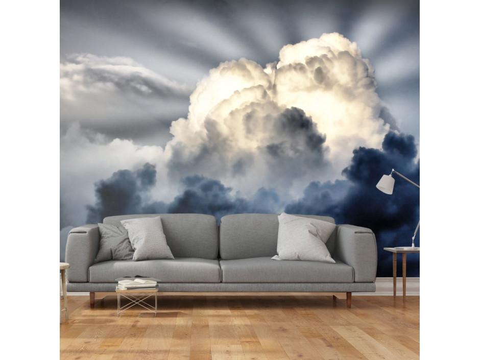Papier peint  Rayons de soleil sur un ciel nuageux