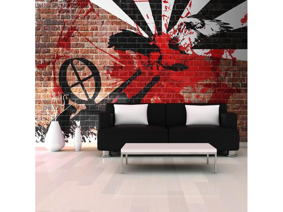 Papier peint - Graffiti sur un mur de brique